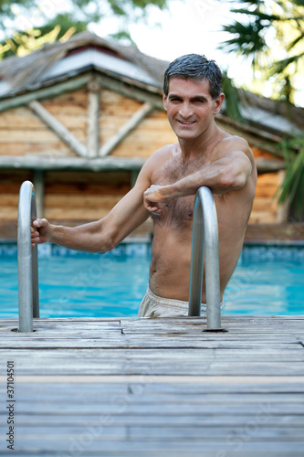 Man Standing in Pool