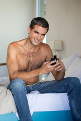 Shirtless Man Using Cell Phone