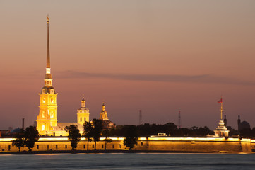 Illuminated Peter and Paul fortress at sunset, St Petersburg