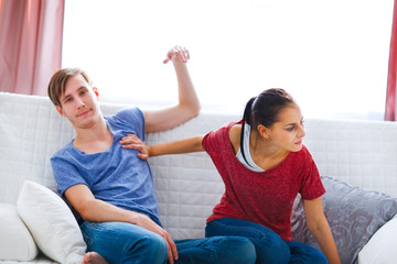 Young couple quarreling at home