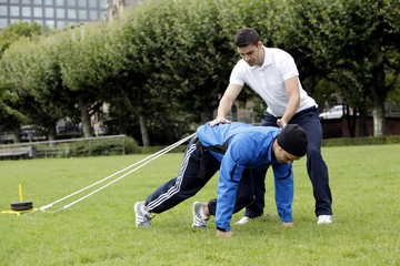 Training outdoor mit Gewichten