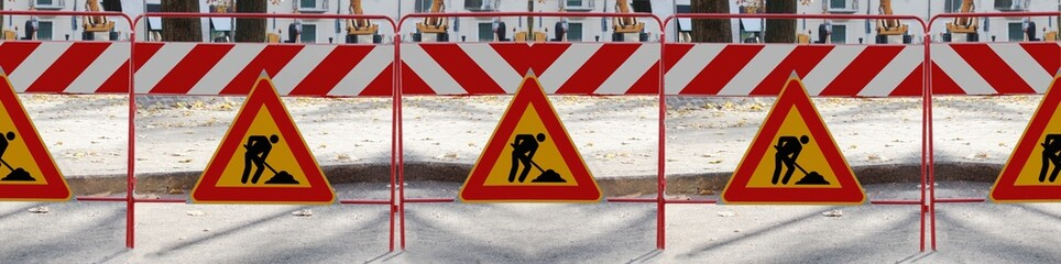 "Series of ""man at work"" signs"