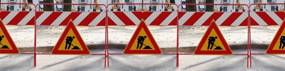 "Series of ""man at work"" signs"