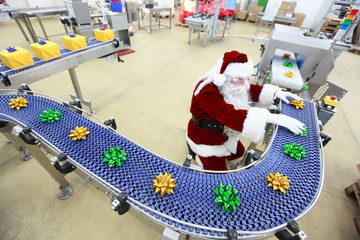 Santa Claus working in Christmas Gifts Factory
