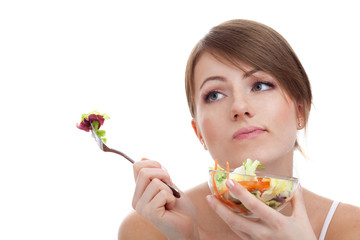 Sad woman on diet with vegetables