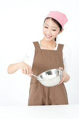 attractive asian woman cooking