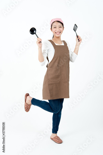 attractive asian woman with cooking equipment