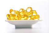 Cod liver oil pills in a white bowl