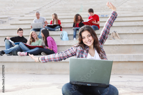 students on campus working outdoors