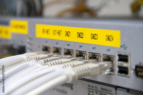 Ethernet cables connected to a Firewall