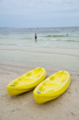 yellow canoes on the beach