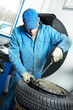 machanic repairman at tyre fitting