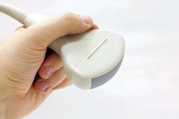 Abdominal convex ultrasound probe in left hand