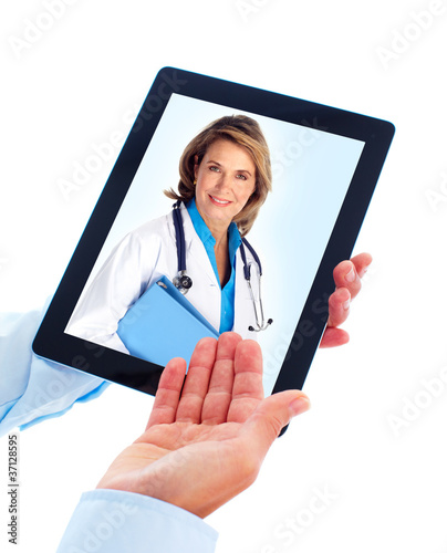 Tablet computer and doctor woman.