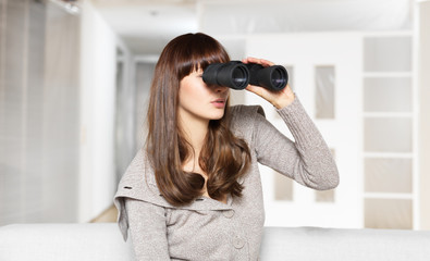 young woman looking through binocular