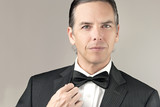 Confident Man In Tux Adjusts Cuff poster