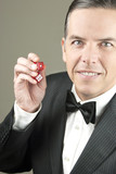 Confient Gentleman In Tux Holding Dice, Leaning poster