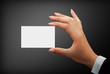 business white card in a woman hands