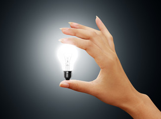 light bulb small on woman hand