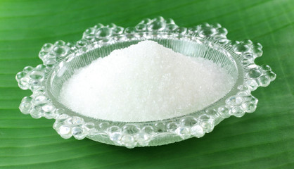Fresh sugar on a transparent plate