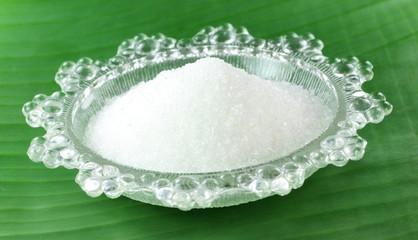 Fresh sugar on a transparent plate