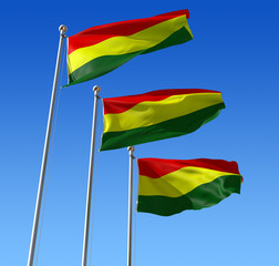 Three flags of Benin waving in the wind against blue sky.