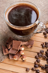 Cup of coffee, chocolate with nuts and coffee beans