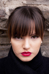 Portrait of beautiful woman with make-up and red lipstick