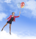 Businesswoman floating with balloons