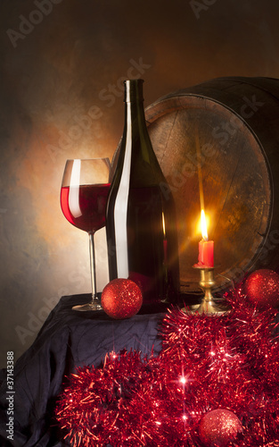 still life with red wine and candle