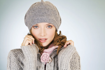 A young woman wearing a grey woollen hat