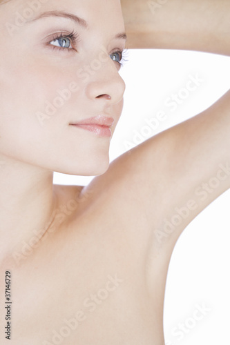 A young woman showing her armpit