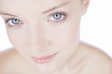 Portrait of a young woman with blue eyes, cropped