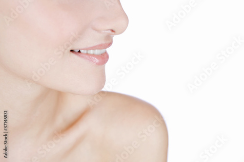 A lower half of a young woman's face, smiling