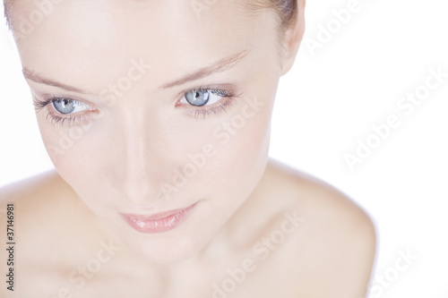 Portrait of a young woman with blue eyes, looking away