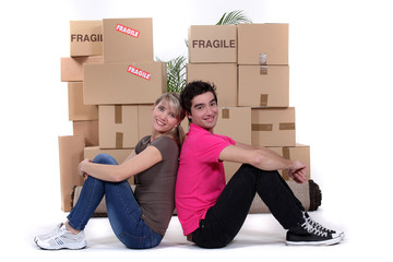 young couple moving together