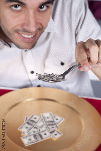 Man eating little dollar banknote