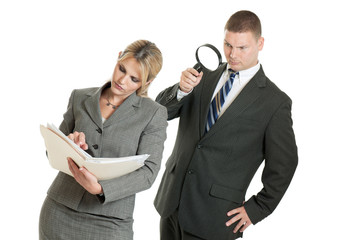 Business man spying on business woman with magnifying glass