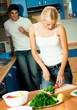 Couple making salad at home