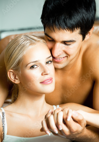 Portrait of young embracing couple