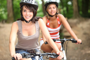 portrait of 2 girls on bikes