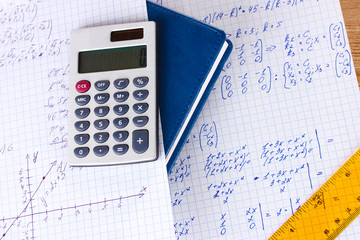 Math on copybook page closeup