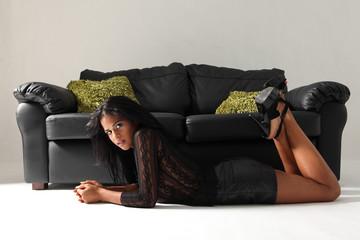 Beautiful ethnic fashion model in black mini-skirt