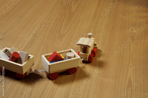 woodden train toy on parquet.