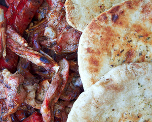 barbecue food and pita bread