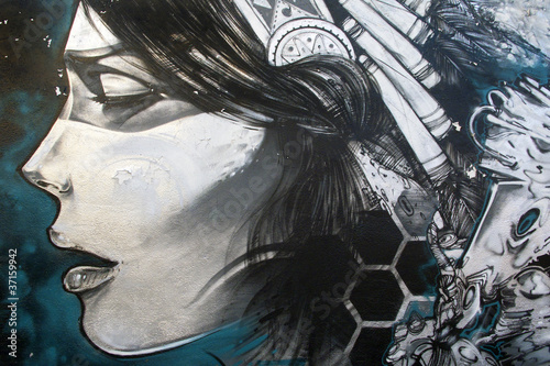 canvas print picture Arte urbano. Graffiti de una mujer en una pared