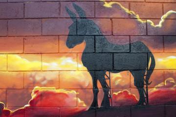 Arte urbano. Graffiti de un burro en una puesta de sol