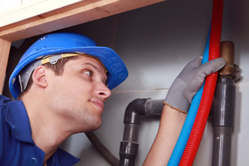 Plumber with hot and cold flexible water pipes