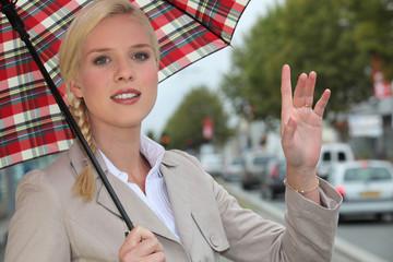 Woman hailing a taxi