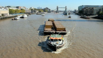 Barge on the River Thames with Tower Bridge in the background